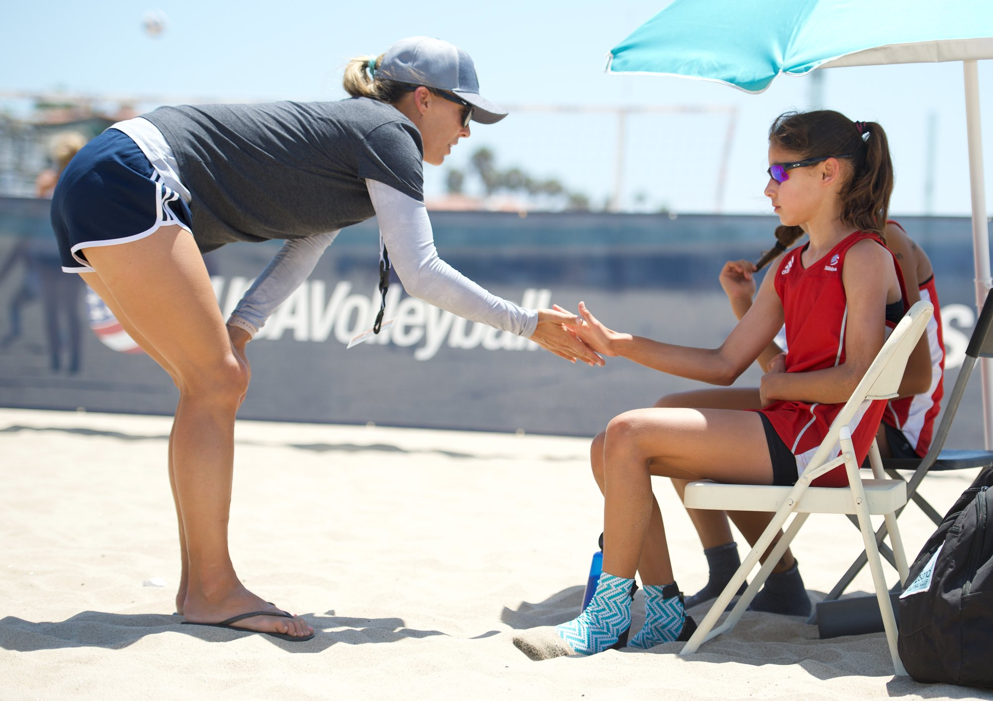 Coach with Beach Athlete