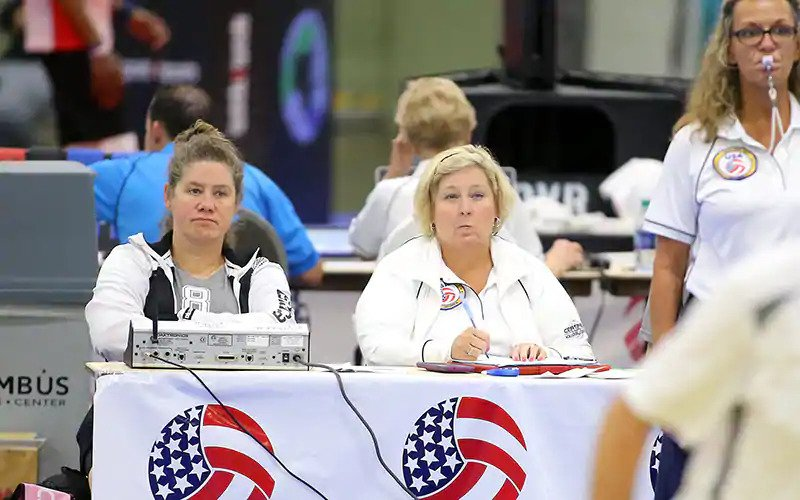 Two women sitting at scoring table
