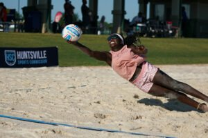 Beach Volleyball Player diving for the ball