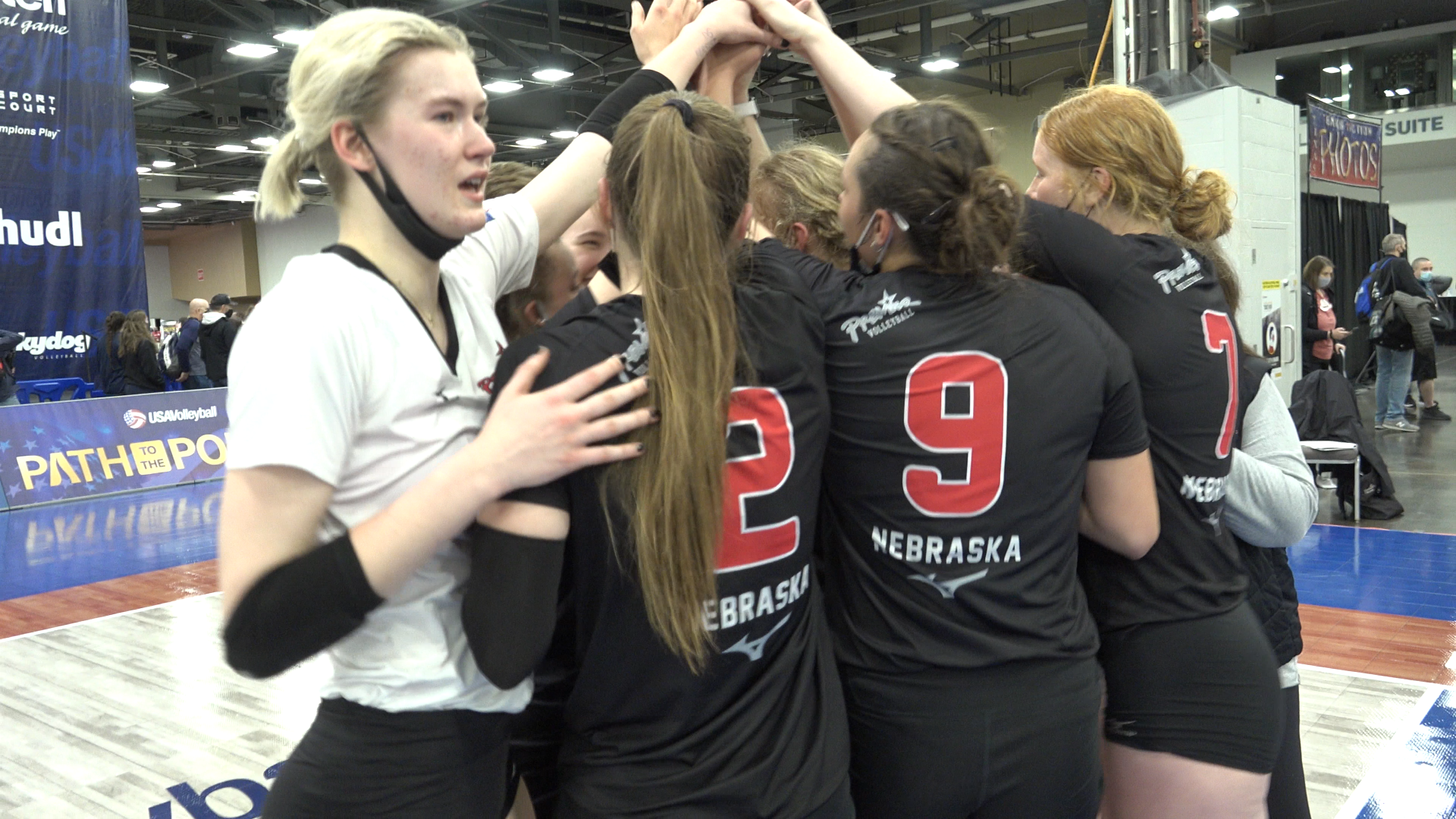 Premier Nebraska 18 Gold huddle and celebrate together after winning the 18 Open Division National Championship.