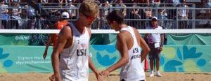 boys on beach shaking hands