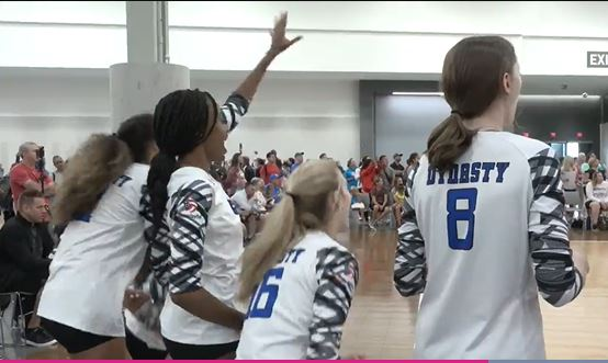 team cheering from bench