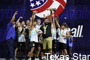 Boys volleyball team holding trophy