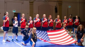 Women's sitting team at national anthem
