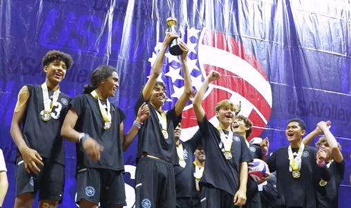 Boys raising trophy