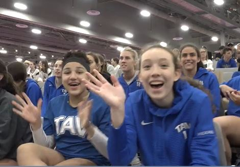 Athletes from TAV waving at the camera