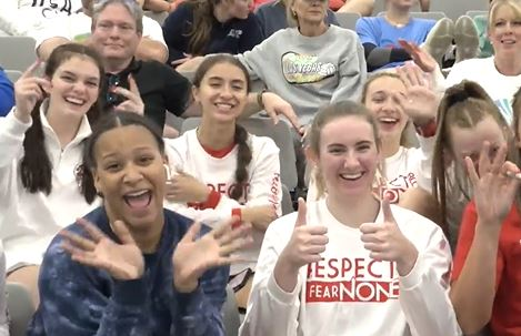 Girls waving at camera