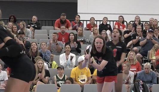 Coach cheering her team
