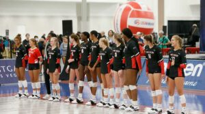 Girls volleyball players line up to begin play