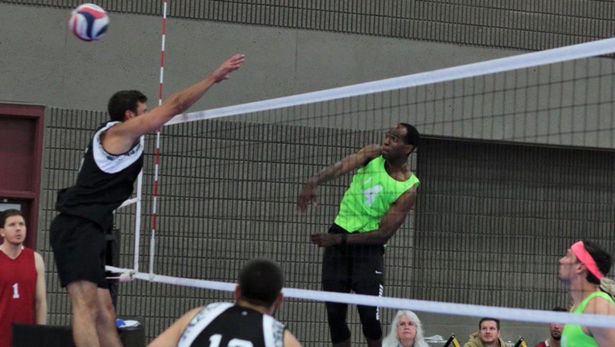 Man hitting the ball at opens