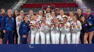 U.S. Women's Sitting Team holding gold medals at the Paralympic Games