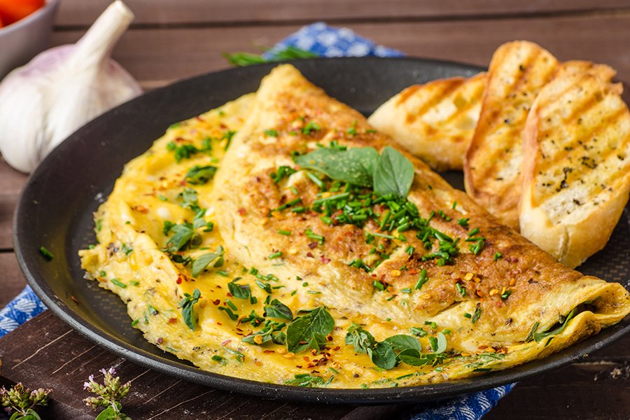 Herb omelette with chives and oregano sprinkled with chili flakes